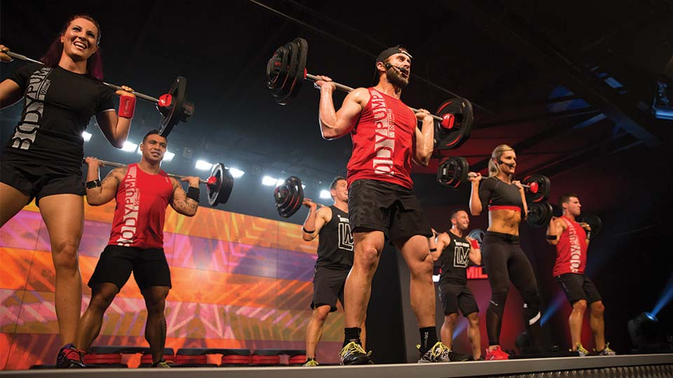 Les Mills fitness instructor weight lifting
