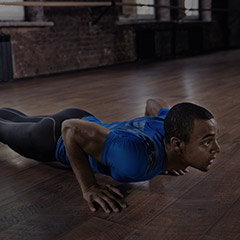 Les Mills man doing push-ups