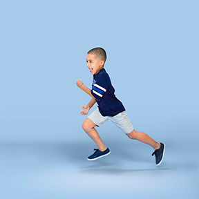 Little boy running keeping active