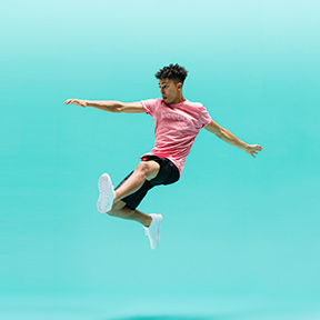 Amped teen jumping martial art kicks