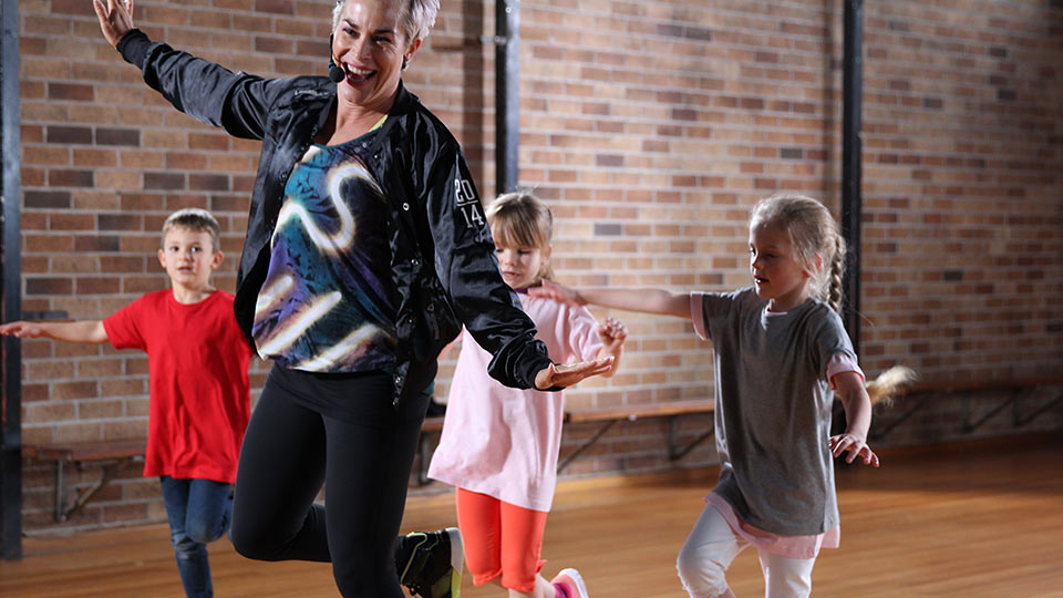 Children with instructor in an exercise class