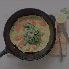 smoked salmon omelette in a skillet