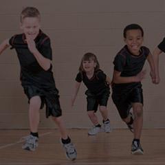 three children running in a fitness workout class