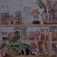 Pantry with glass jars and wooden shelves