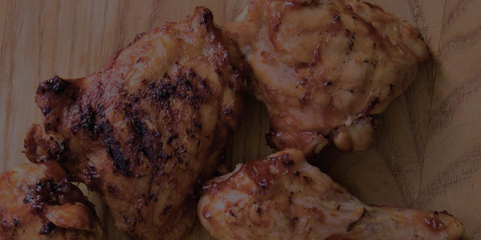 Cooked Chicken protein on a wooden block