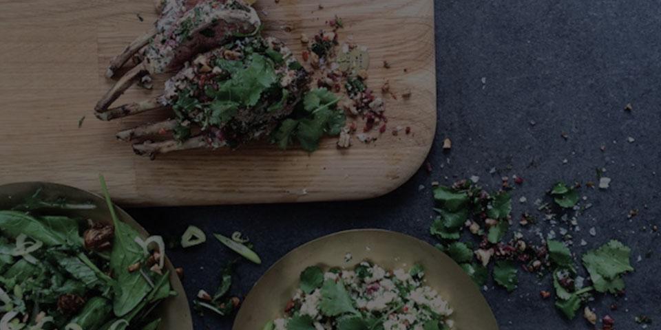 rack of lamb couscous salad on a wooden block