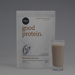 Les Mills Good Protein packet with a glass