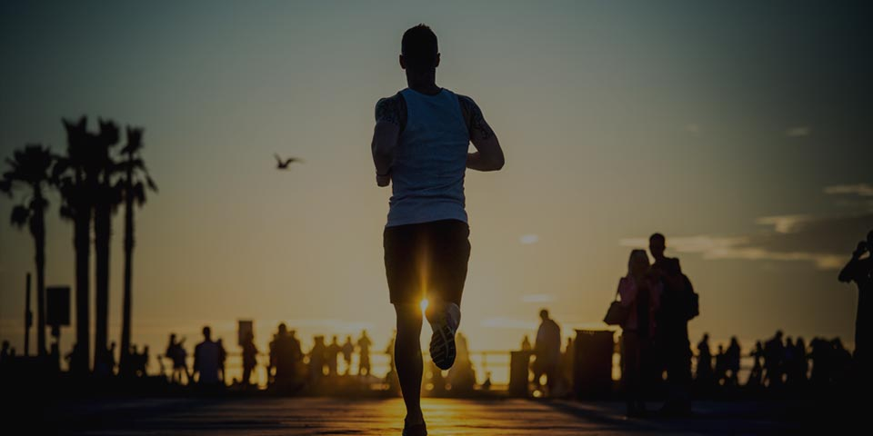 Man running at sunset