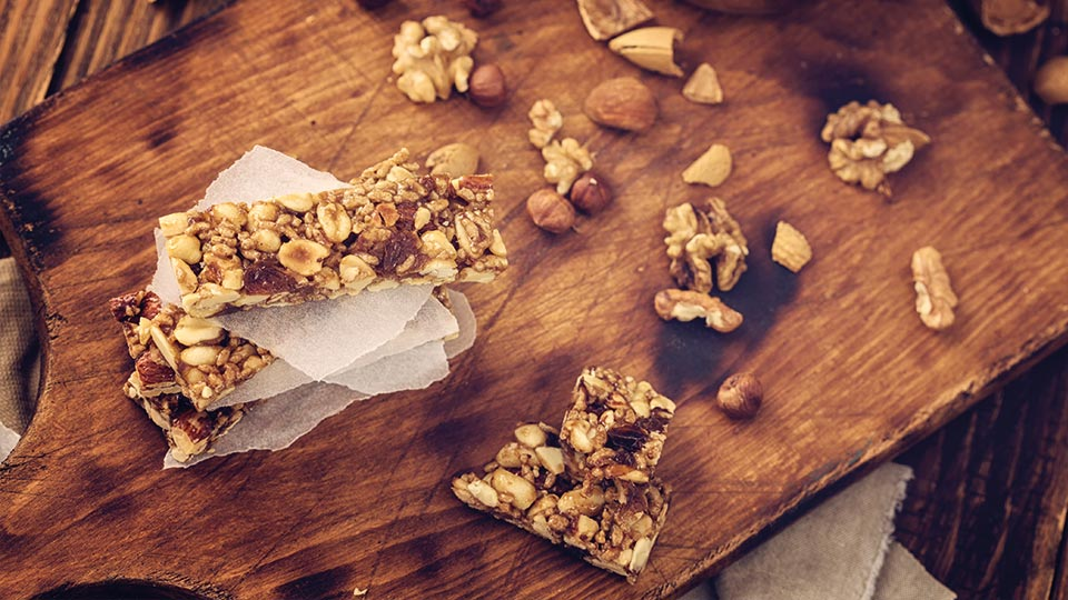 nut protein bar on wooden chopping board