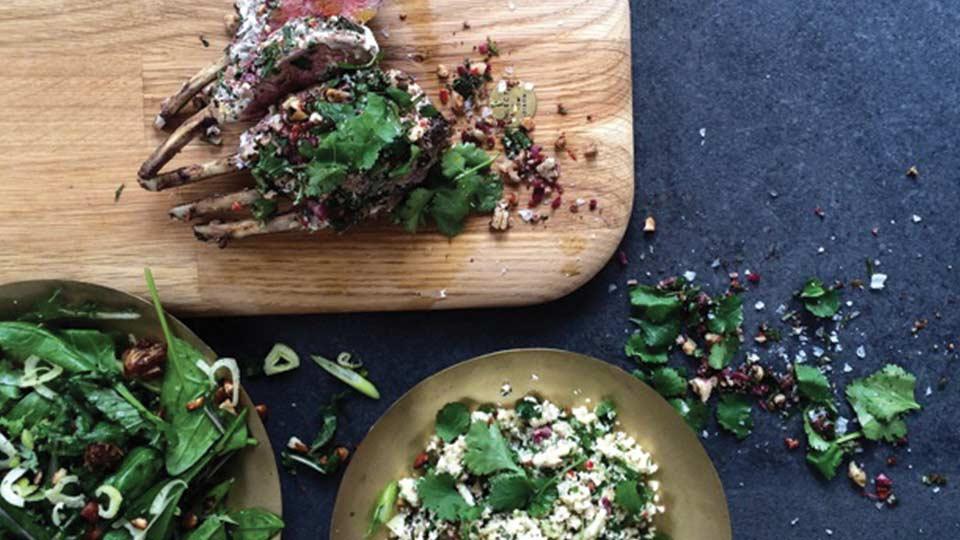 rack of lamb couscous salad on wooden block