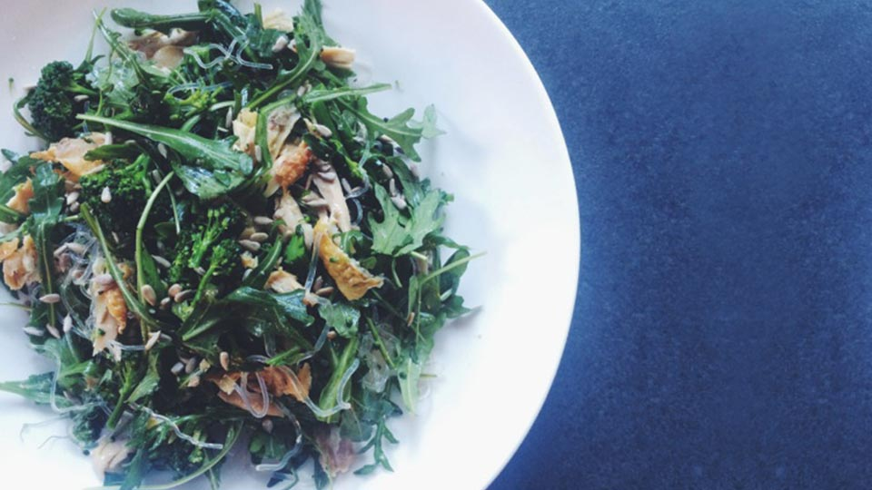 rocket broccoli sunflower seed salad in bowl