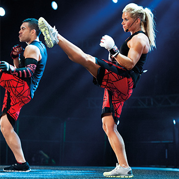 Female Instructor teaching a BODYCOMBAT class