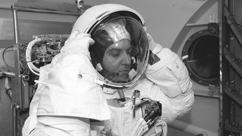 NASA engineer, Luca Callini, putting on his spacesuit helmet