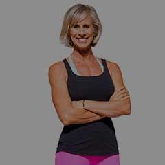 Jackie Mills smiling cross arms