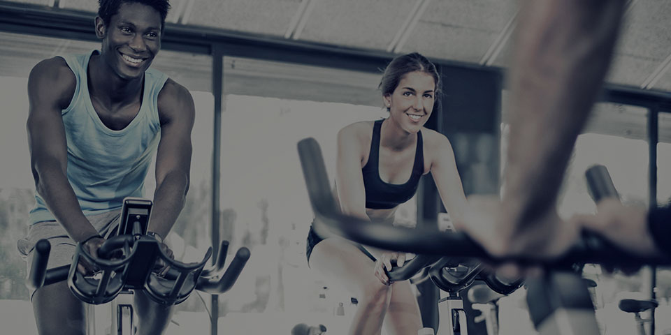 People doing an indoor cycling group fitness