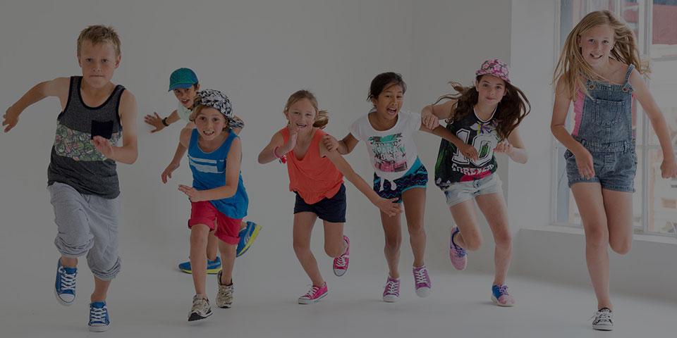 six children running in a fitness workout class
