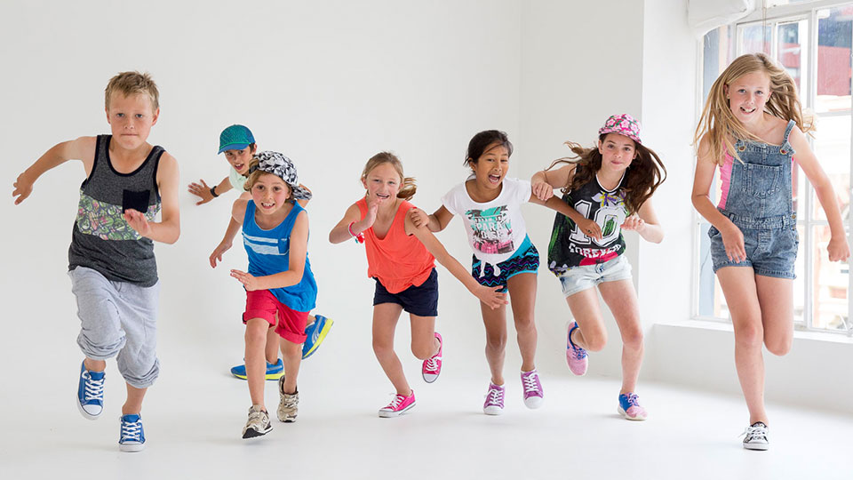 Children running in a group exercise class