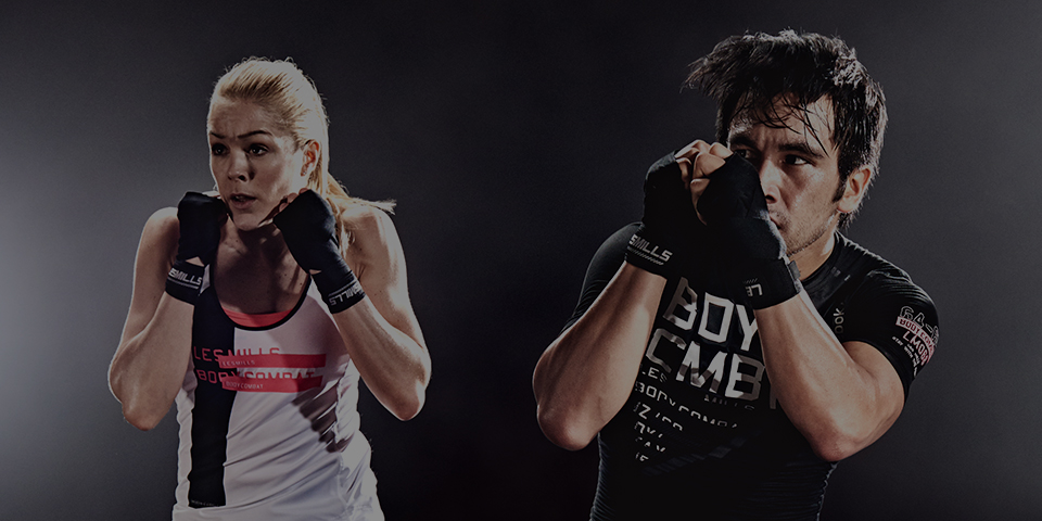 Man and woman in a BODYCOMBAT fitness class