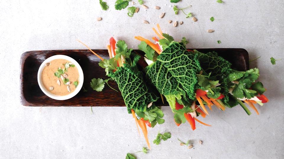 salad rolls on a serving board