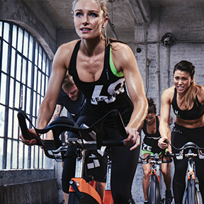 Women doing high intensity training cycle workout