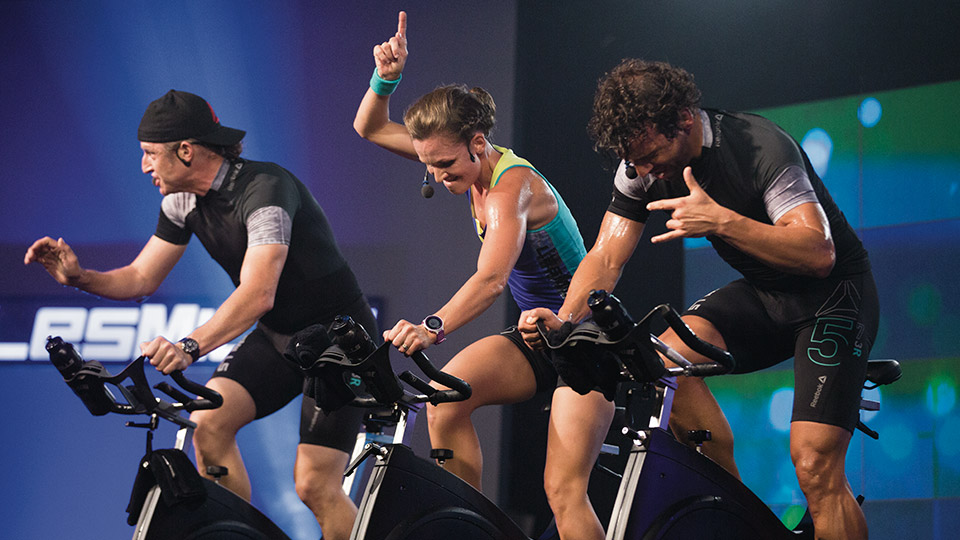 Les Mills instructors instructing an RPM class