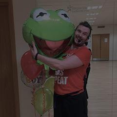 Man hugging mascot