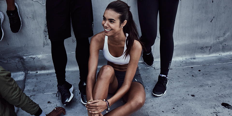 Woman sitting down after a Les Mills fitness class