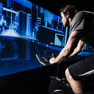 man in a virtual cycle studio workout