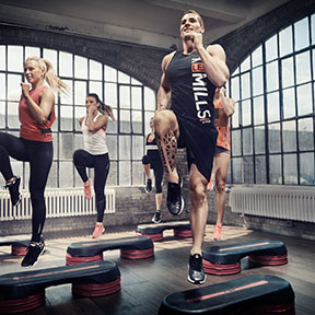 Raised knee jumping off step group workout